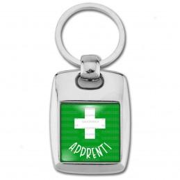 Porte Clés Rectangle Acier 2 Faces Apprenti en Pharmacie Croix Fond Vert