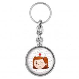 Porte-Clés forme Montre Antique 2 faces Infirmière Tête Clin d'oeil Fond blanc points rouges