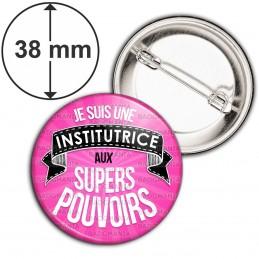 Badge 38mm Epingle Je suis une Institutrice aux Supers Pouvoirs - Fond Rose